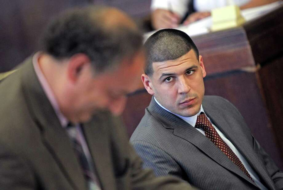 Former New England Patriots NFL football player Aaron Hernandez, right, looks over at his defense attorney James Sultan during his court hearing at Suffolk Superior Court in Boston, Tuesday, Oct. 6, 2015. Lawyers for Hernandez have asked a judge to throw out a search warrant that led police to seize a vehicle that prosecutors say Hernandez was driving when he fatally shot two Boston men in 2012. Photo: Matt Stone/The Boston Herald Via AP, Pool   / POOL Boston Herald