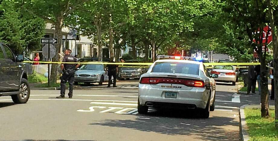 Police investigated a shooting Monday morning near Read and Butler Streets in New Haven. One man, 19, was taken to the hospital with non-life threatening injuries. Wes Duplantier--New Haven Register Photo: Wes Duplantier — New Haven Register