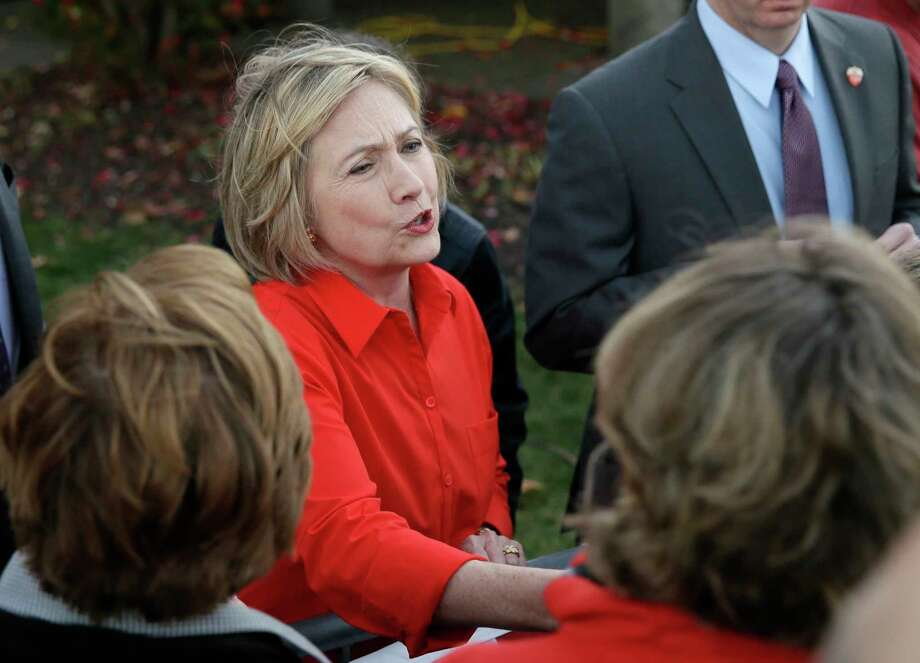 Democratic presidential candidate Hillary Rodham Clinton shakes hands with supporters after a town hall meeting Tuesday, Nov. 3, 2015, in Coralville, Iowa. (AP Photo/Charlie Neibergall) Photo: AP / AP