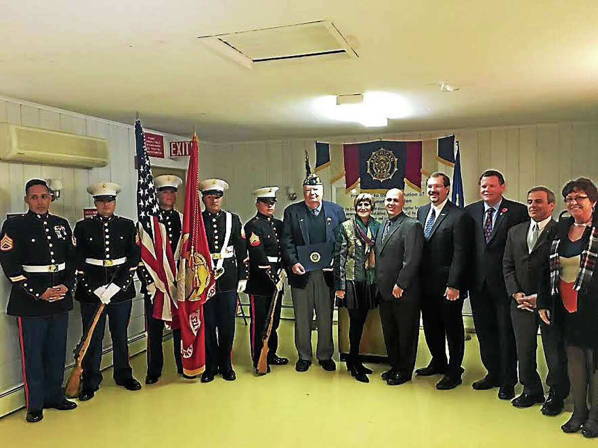 L to R: Staff Sgt. Andrew Cordero and the members of the U.S. Marine Corps Color Guard, Dan Riccio, Jr. of North Haven, U.S. Rep. Rosa DeLauro, D-3, John DeBisschop, III, of Naugatuck, Michael Skelps of Middlefield, Greg Smith of Milford, First Selectman Michael Freda and State Rep. Kim Rose.