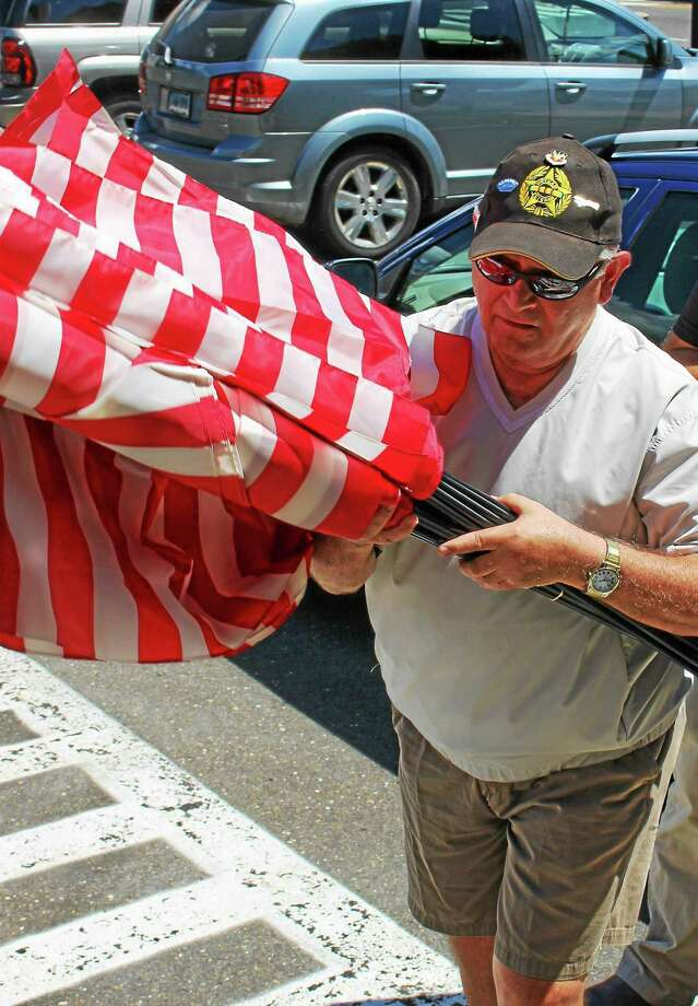 Vietnam veteran Robert Federico delivers flags to Derby City Hall Thursday. Photo: Jean Falbo-Sosnovich — New Haven Register