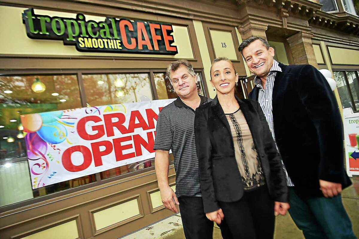 Mark Lukachko, left, of Chatham, New Jersey, co-owner of Tropical Smoothie Cafe at 15 Dixwell Ave. in New Haven, and his business partners, Magdalena and Zarko Stojanovski, of Las Vegas, at Tuesday's grand opening celebration.