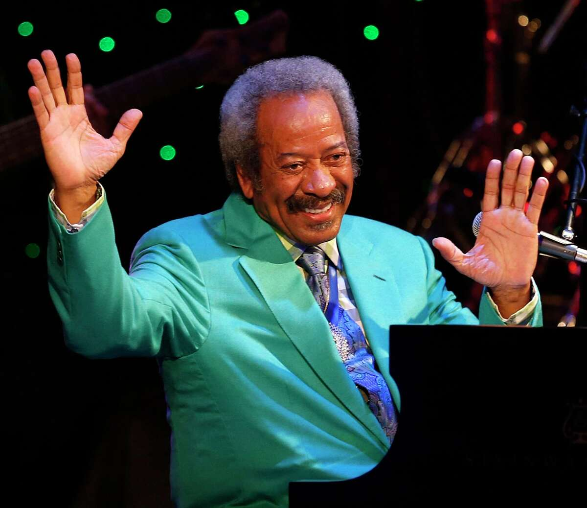 In this Tuesday April 30, 2013, photo, Allen Toussaint thanks the audience after a benefit concert/tribute in his honor at Harrah's New Orleans Theatre, in New Orleans. Legendary New Orleans musician and composer Toussaint died Monday, Nov. 9, 2015, after suffering a heart attack following a concert he performed in Madrid. He was 77.