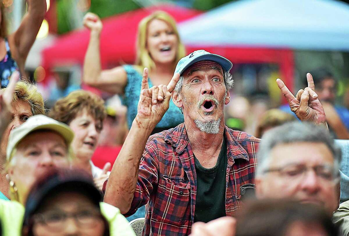 """Vietnam veteran Day Gay sings along as Tony Orlando performs Neil Diamond's 1980 hit, """"America."""" Throughout the song, Orlando recognized veterans, one war at a time, and asked them to stand, and the crowd sang along at the East Haven Fall Festival at the East Haven Town Green, Saturday, September 12, 2015."""