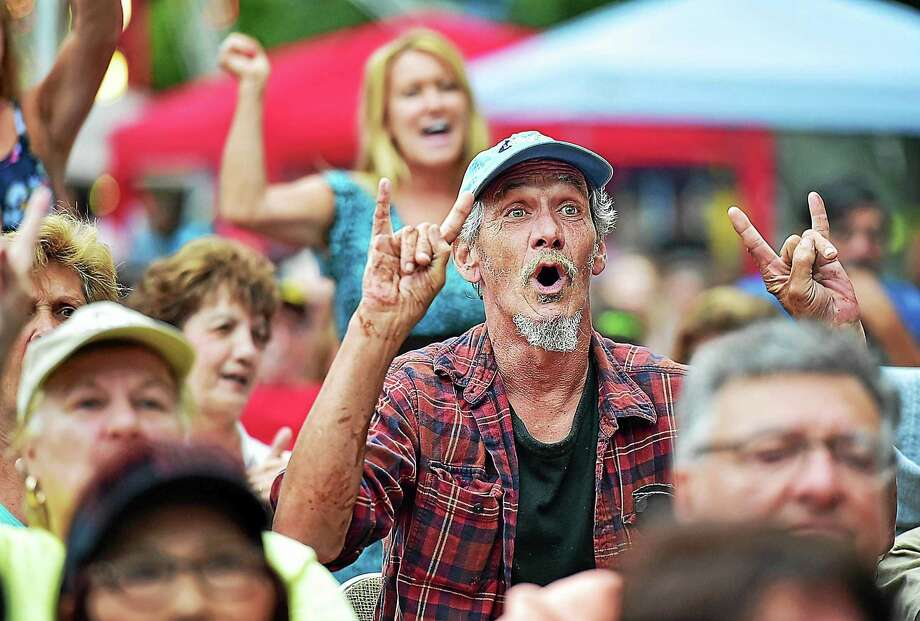 "Vietnam veteran Day Gay sings along as Tony Orlando performs Neil Diamond's 1980 hit, ""America."" Throughout the song, Orlando recognized veterans, one war at a time, and asked them to stand, and the crowd sang along at the East Haven Fall Festival at the East Haven Town Green, Saturday, September 12, 2015. Photo: (Catherine Avalone — New Haven Register) / Catherine Avalone/New Haven Register"