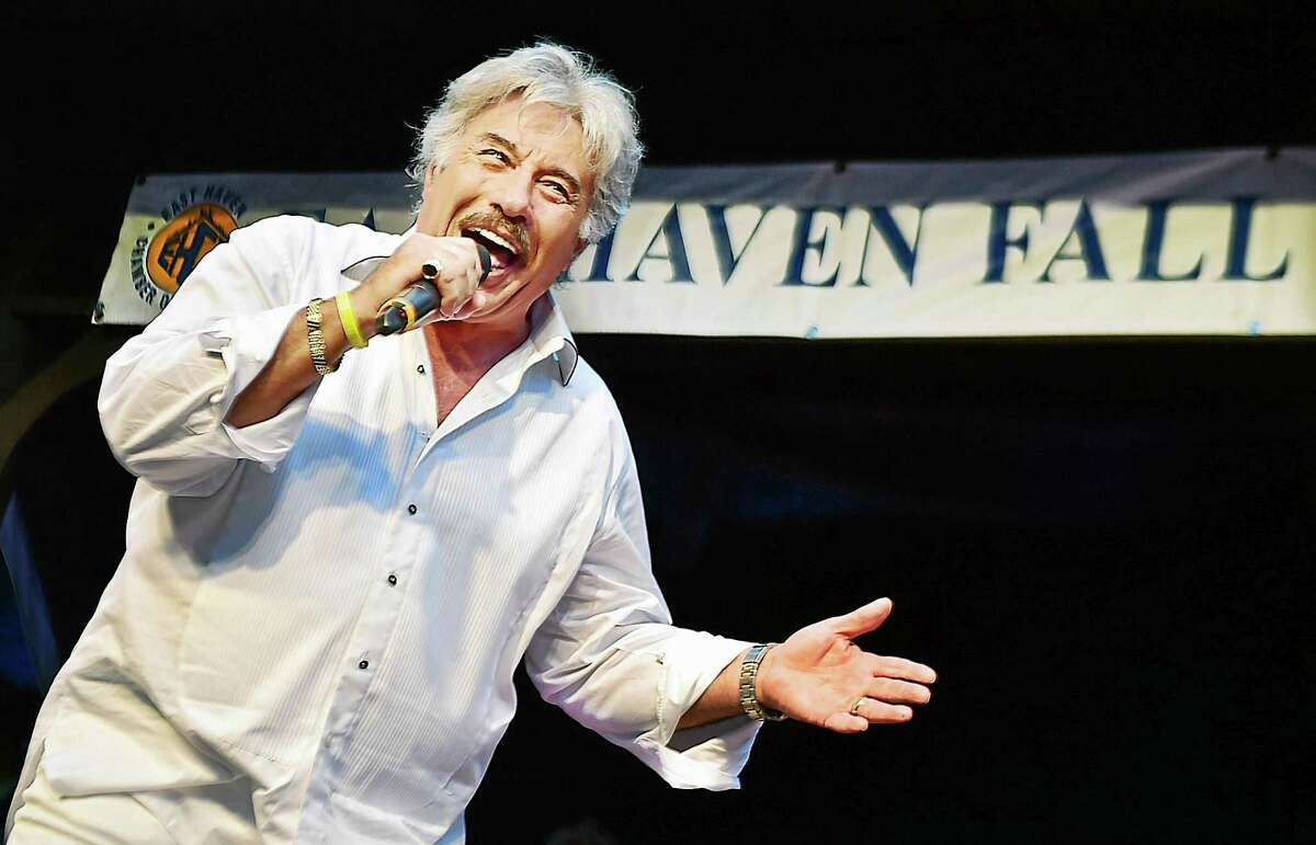 """Tony Orlando performs """"Tie a Yellow Ribbon Round the Ole Oak Tree"""" in front of hundreds at the East Haven Fall Festival at the East Haven Town Green, Saturday, September 12, 2015. Originally performed by Tony Orlando and Dawn, in 1973, """"Tie a Yellow Ribbon Round the Ole Oak Tree"""" reached number one in April 1973 and in 2008, Billboard ranked the song as the 37th biggest song of all time."""