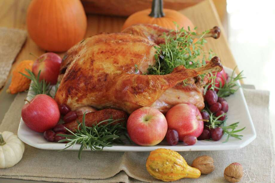 Regardless of how you cook the turkey, experts say to make sure you let it sit, undisturbed, on a cutting board or platter for at least 30 minutes before carving. This allows the bird to finish cooking more gently and reabsorb all of its juices, producing moist meat. Photo: Matthew Mead - Associated Press   / FR170582 AP