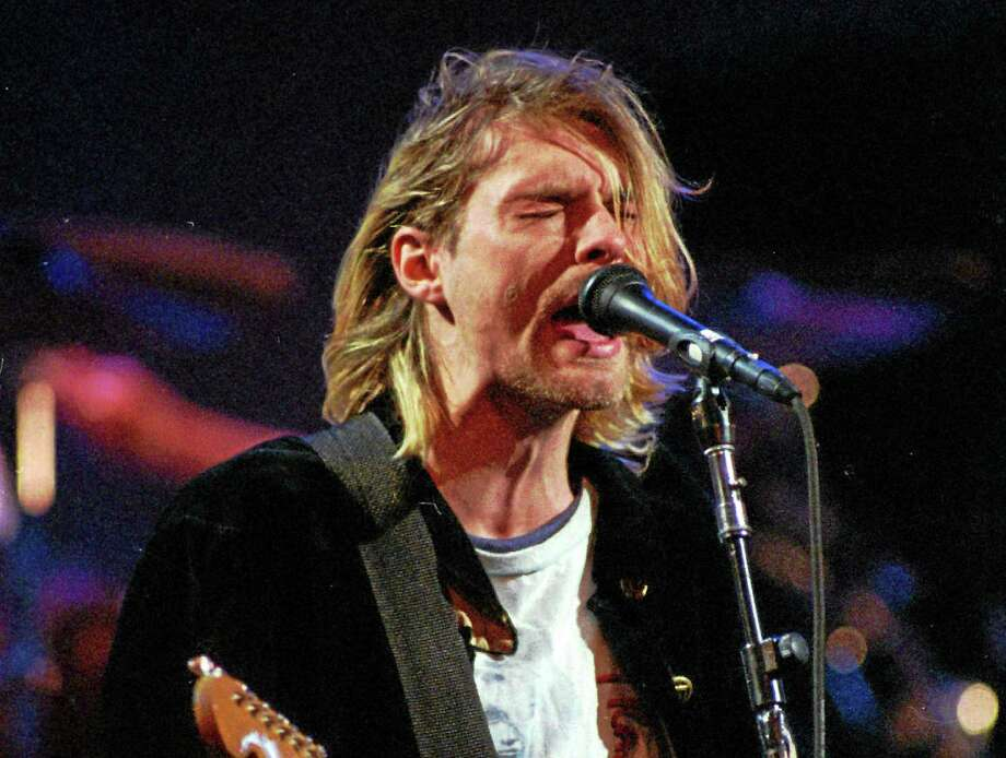 This Dec. 13, 1993 photo shows Kurt Cobain of the Seattle band Nirvana performing in Seattle, Wash. Photo: AP Photo/Robert Sorbo, File   / AP