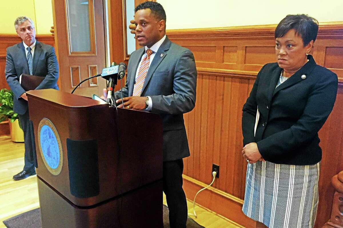 From left, New Haven City Budget Director Joe Clerkin, city Controller Daryl Jones and Mayor Toni Harp during a press conference announcing the city's balanced 2015 fiscal year budget Tuesday at City Hall.