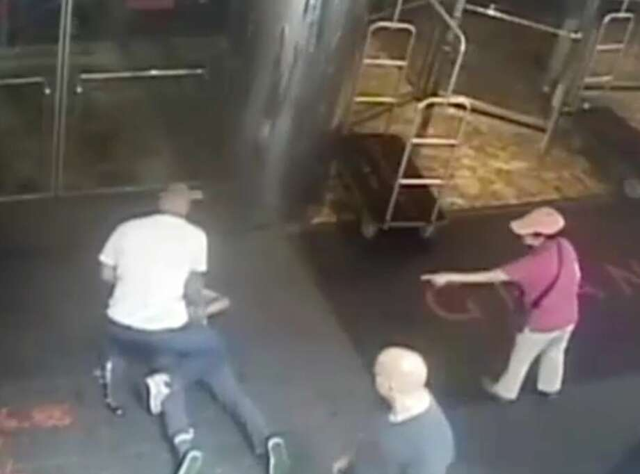 This image taken from a surveillance camera and released by the New York Police Department shows former tennis star James Blake, on ground, being arrested by plainclothes officer James Frascatore outside of the Grand Hyatt New York hotel on Wednesday. Photo: The Associated Press   / NYPD