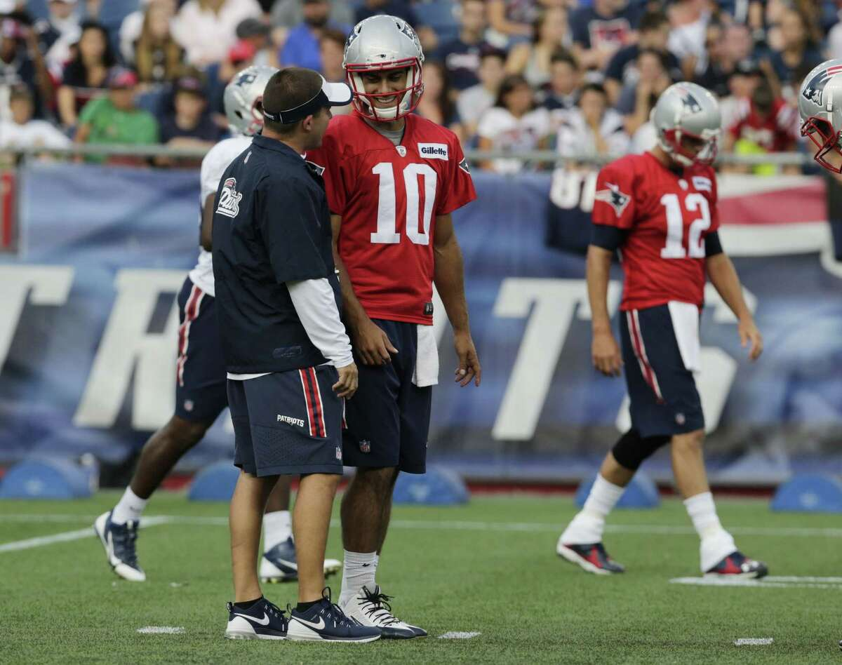 New England Patriots quarterback Jimmy Garoppolo (10) talks with offensive coordinator Josh McDaniels during training camp last week in Foxborough, Mass.