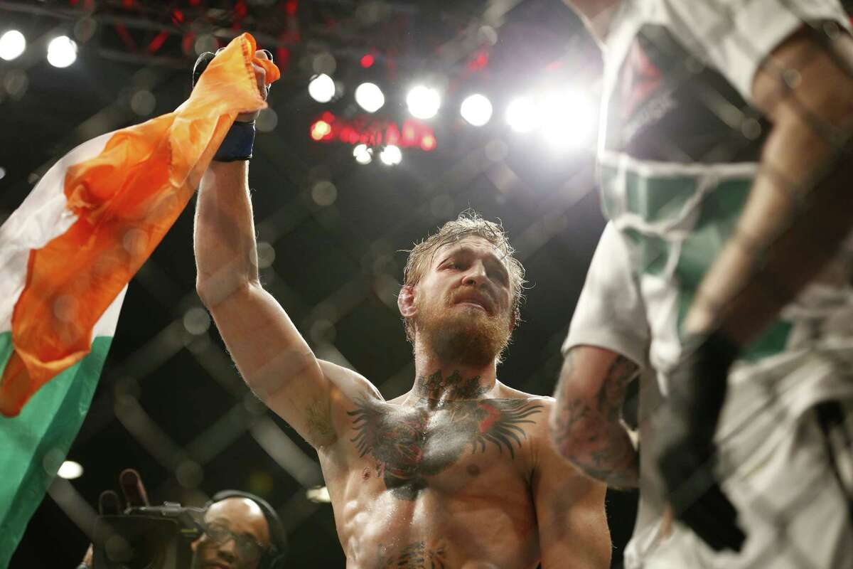 Conor McGregor celebrates after defeating Chad Mendes in their featherweight title mixed martial arts bout at UFC 189 on Saturday in Las Vegas.