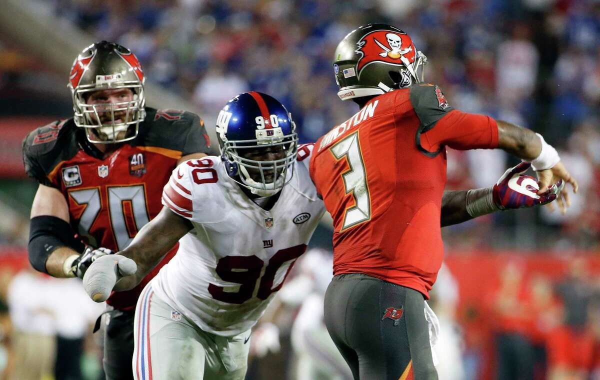 Giants defensive end Jason Pierre-Paul (90) hits Buccaneers quarterback Jameis Winston during Sunday's game.