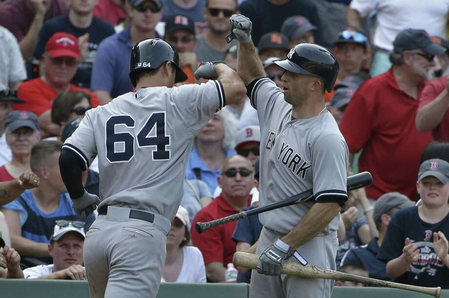 The Yankees' Rob Refsnyder, left, celebrates with Brett Gardner after hitting a two-run home run in the ninth inning Sunday. Photo: Steven Senne — The Associated Press   / AP