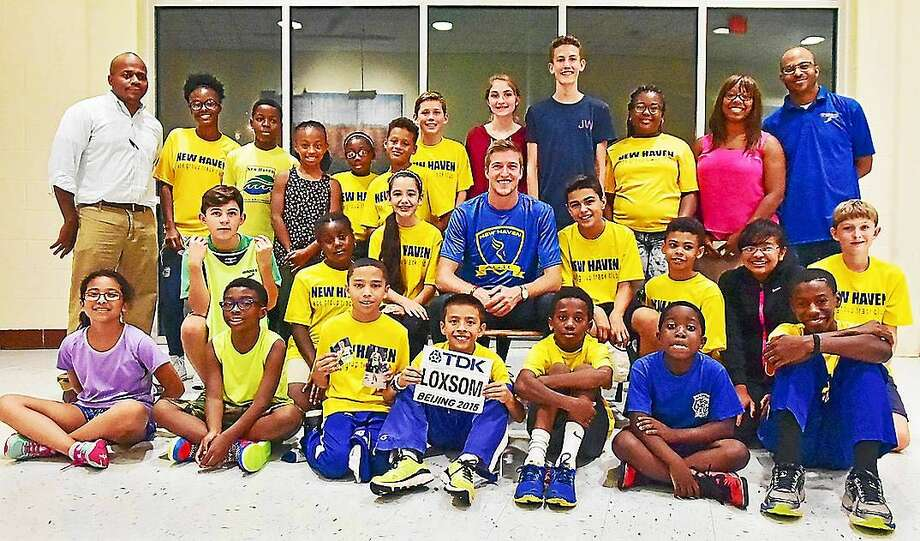 New Haven native Cas Loxsom and members of the New Haven Age Group Track Club at Wilbur Cross High School on Wednesday. Photo: Catherine Avalone — New Haven Register