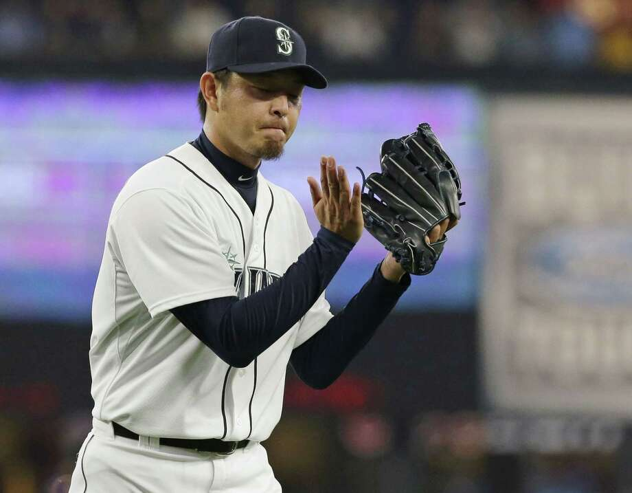 Mariners starter Hisashi Iwakuma threw a no-hitter against the Baltimore Orioles on Wednesday in Seattle. Photo: Ted S. Warren — The Associated Press   / AP