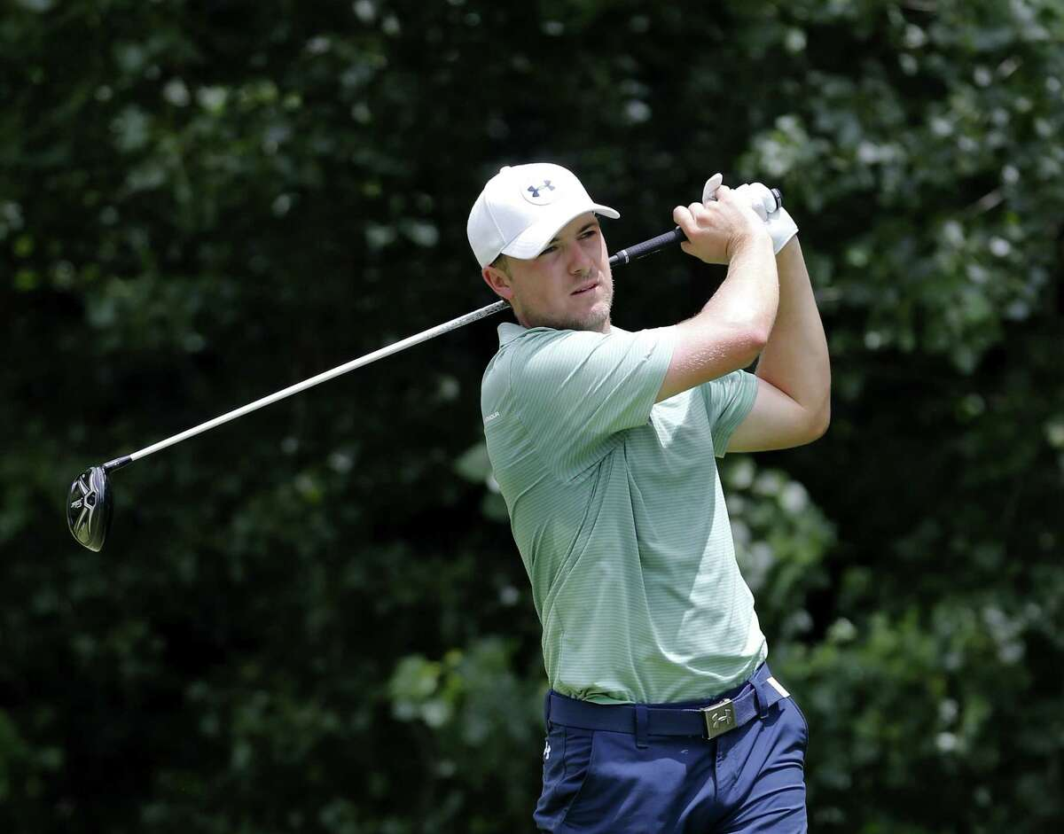 Jordan Spieth watches his tee shot on the second hole during the final round of the John Deere Classic on Sunday.