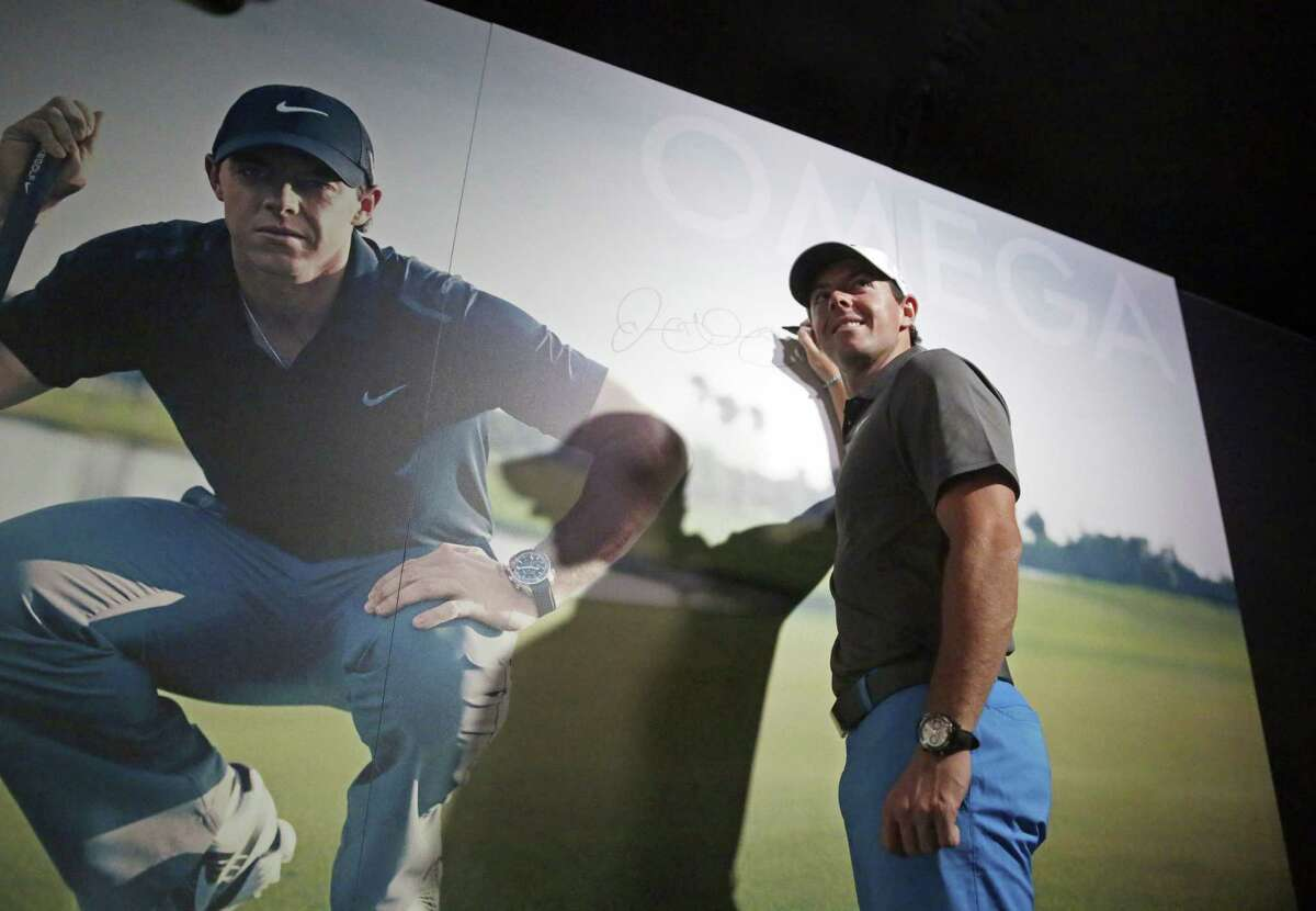 Rory McIlroy signs a wall at the Omega exhibit before a practice round for the PGA Championship Wednesday at Whistling Straits in Haven, Wis.