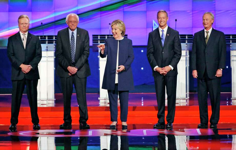 The Democrats' presidential candidates, from left, former Virginia Sen. Jim Webb, Sen. Bernie Sanders of Vermont, Hillary Rodham Clinton, former Maryland Gov. Martin O'Malley and former Rhode Island Gov. Lincoln Chafee take the stage before the CNN Democratic presidential debate Tuesday in Las Vegas. Photo: John Locher — The Associated Press   / AP