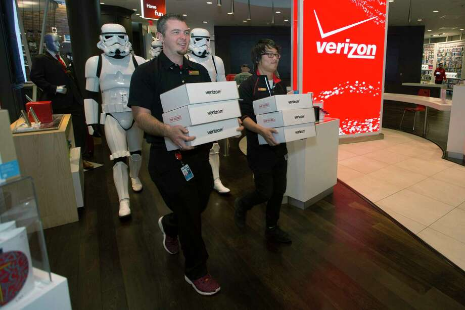 Stormtroopers escorted the first custom Star Wars Google Cardboard Virtual Reality viewers to Verizon's Minneapolis flagship store. The viewers, available exclusively through Verizon stores, give Verizon customers an immersive experience of nine virtual reality missions found on the official Star Wars app, all of which lead into the opening of Star Wars: The Force Awakens movie, premiering on Friday, Dec. 18, 2015. Photo: Photo By Verizon Via AP Images   / ©2015 Bruce Kluckhohn
