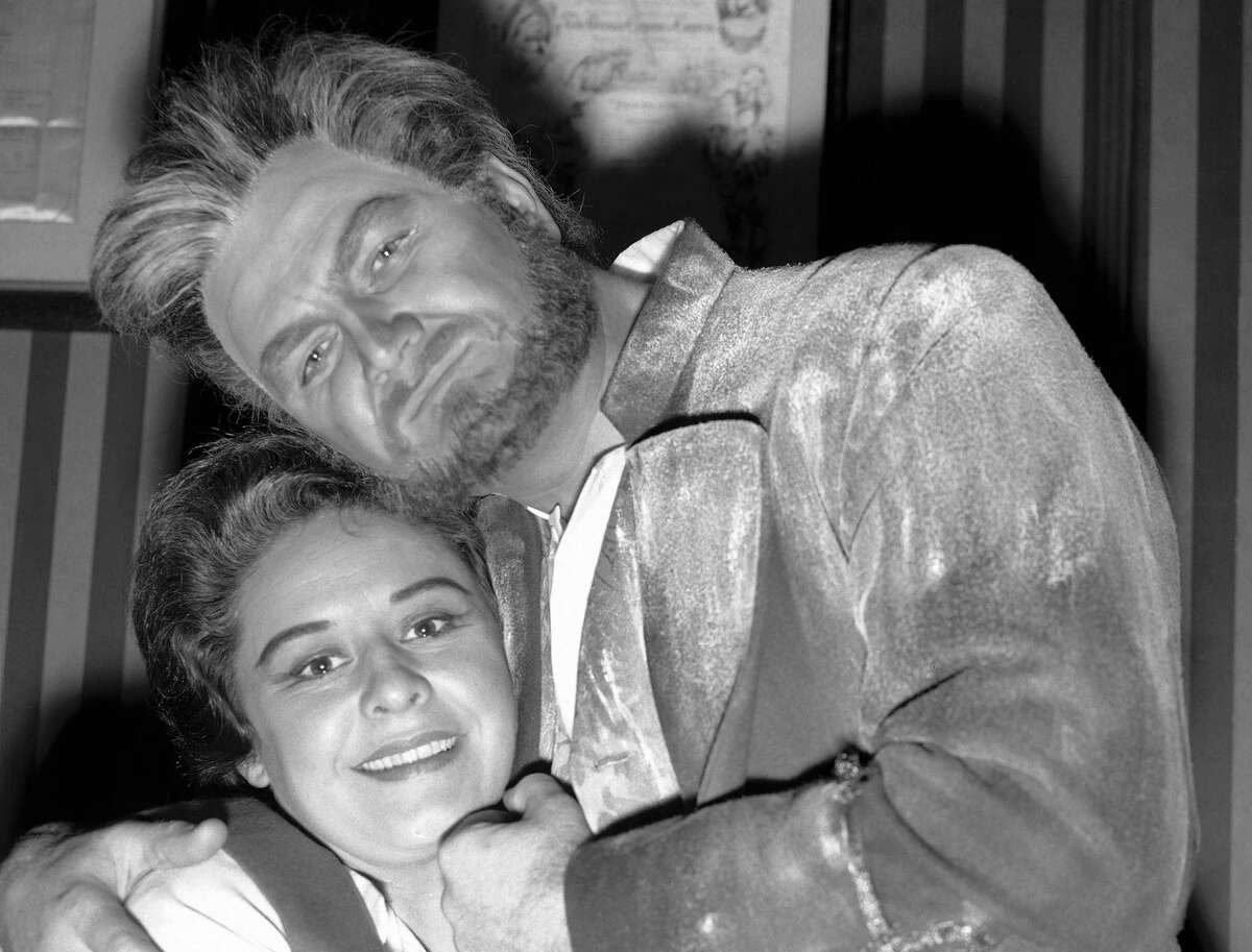 """In this 1961 file photo, Jon Vickers, in the role of Florestan, and Sena Jurinac, as Leonora, pose together at the Royal Opera House in Covent Garden, London, during the photo-call for the New London production of """"Fidelio""""."""