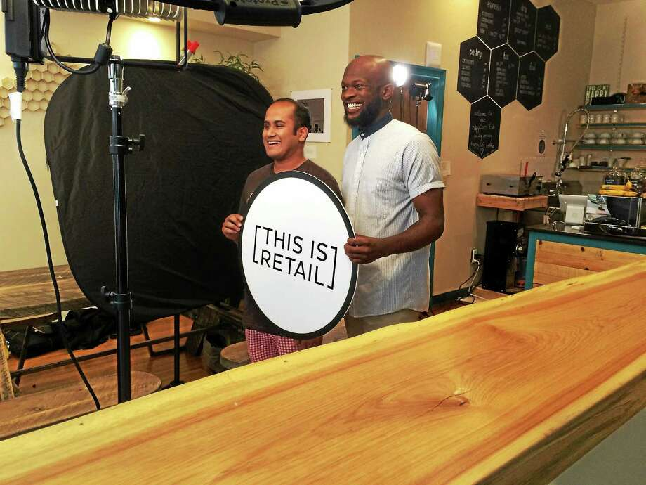 Vishal Patel, left, and Onyeka Obiocha, co-owners of Happiness Lab in New Haven, film a promotional spot with a camera crew from the National Retail Federation Tuesday. Photo: LUTHER TURMELLE -- NEW HAVEN REGISTER