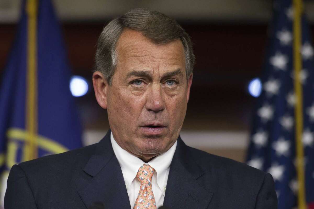 Speaker of the House John Boehner, R-Ohio, speaks with reporters on Capitol Hill in Washington on July 9.
