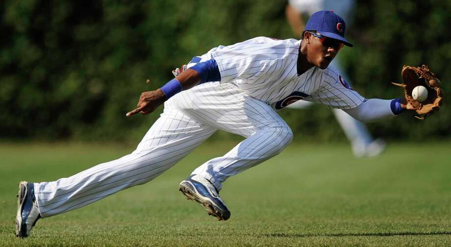 FILE - In this Aug. 21, 2010, file photo, Chicago Cubs shortstop Starlin Castro fields an infield single by Atlanta Braves' Jason Heyward during the third inning of a baseball game in Chicago. The Cubs traded Castro to the New York Yankees in exchange for pitcher Adam Warren and a player to be named later, the Yankees announced Tuesday, Dec. 8, 2015.  (AP Photo/Paul Beaty, File) Photo: AP / FR36811 AP
