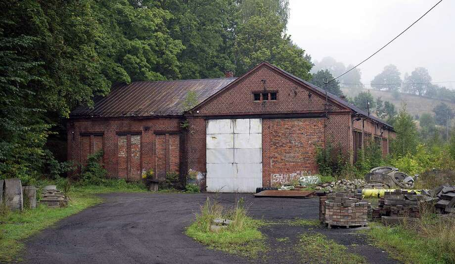 The abandoned building of a German Nazi-era railway installation in Walim, near Walbrzych, in Poland, photographed on Friday, Sept. 11, 2015.  An explorer says he has found massive underground World War II installations in the neighborhood that were probably intended as an anti-nuclear shelter for Hitler. Photo: AP Photo    / AP