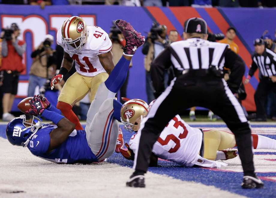 Giants tight end Larry Donnell (84) comes down with a catch for the game-winning touchdown against the 49ers on Sunday night. Photo: Seth Wenig — The Associated Press   / AP