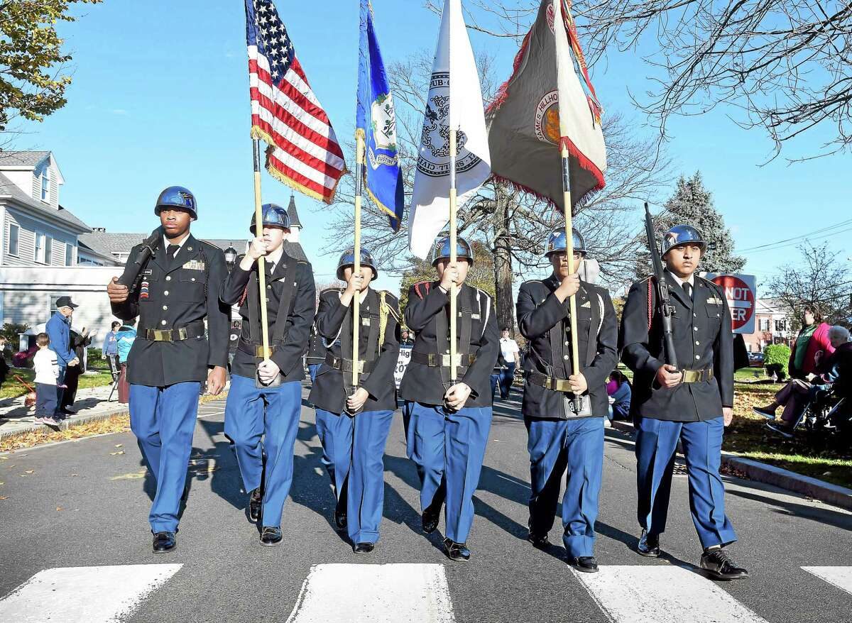 (Arnold Gold-New Haven Register) In this photo, members of the Hillhouse High School Army JROTC march in the Milford Veterans Day Parade on Sunday.