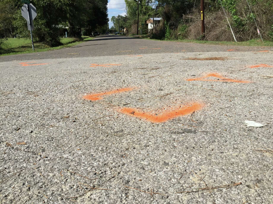 This Nov. 4, 2015 image shows orange paint marking the spot where a 6-year-old boy was shot and killed by Ward 2 city marshals in Marksville, La. The marshals had been chasing a vehicle driven by the boy's father, Chris Few. He was shot in the head, but survived. Photo: Melissa Gregory/The Daily Town Talk Via AP   / The Daily Town Talk