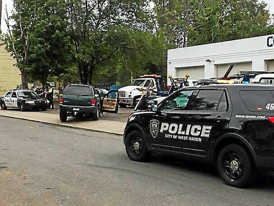A police pursuit ended with an SUV crash in New Haven Friday morning. Photo: Wes Duplantier — New Haven Register