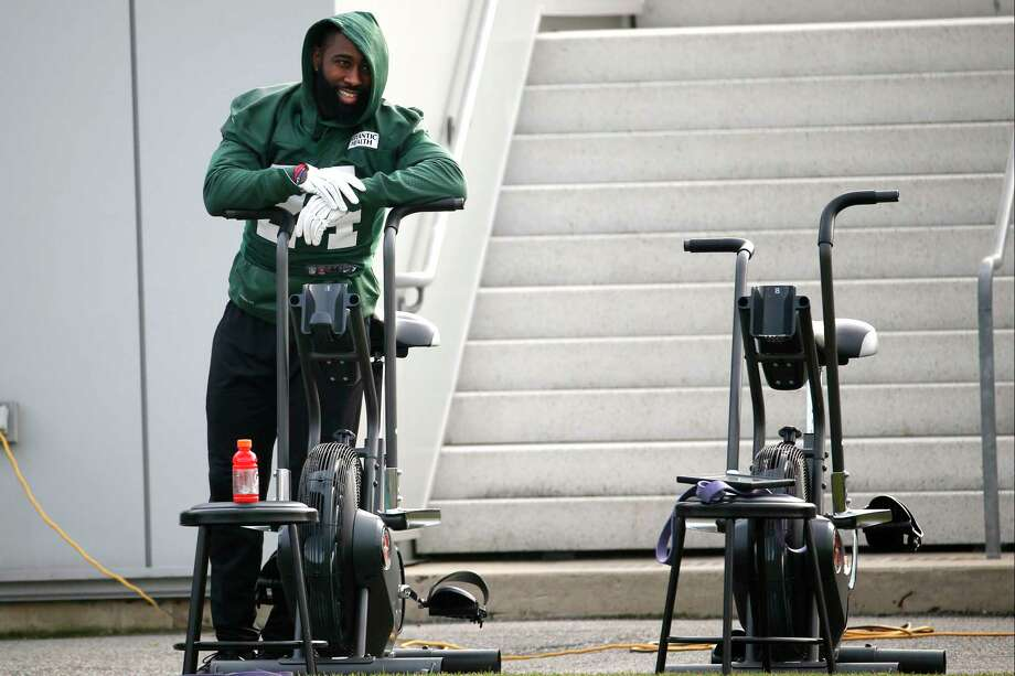 New York Jets cornerback Darrelle Revis hangs out by athletic equipment during practice Wednesday. Photo: Julio Cortez — The Associated Press   / AP