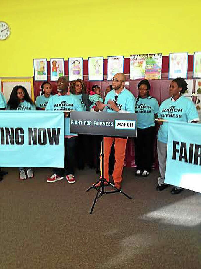 Parent Louis Reed talks about how he believes unequal funding to Connecticut schools perpetuates inequality, Monday at Booker T. Washington Academy in New Haven. Photo: Brian Zahn — New Haven Register