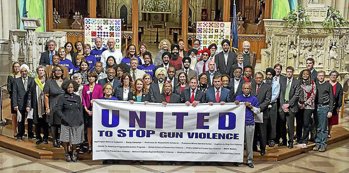 """Faith leaders, gun violence survivors, elected officials and community activists gather at the Washington National Cathedral for a """"United to Stop Gun Violence"""" forum."""