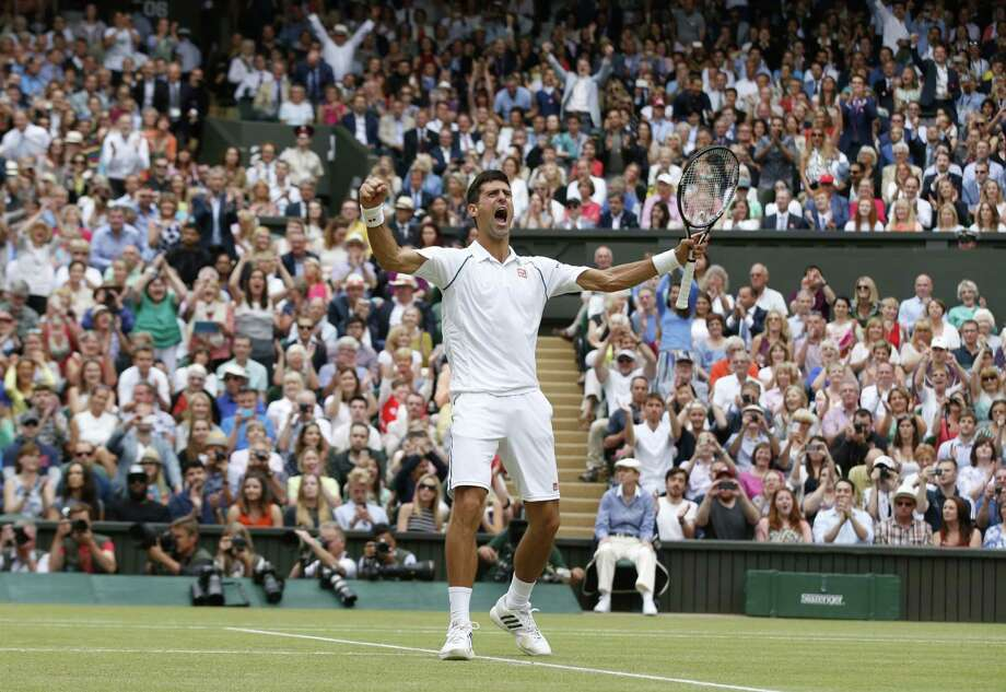 Novak Djokovic of Serbia celebrates winning the men's singles final against Roger Federer of Switzerland at Wimbledon Sunday. Photo: The Associated Press   / AP