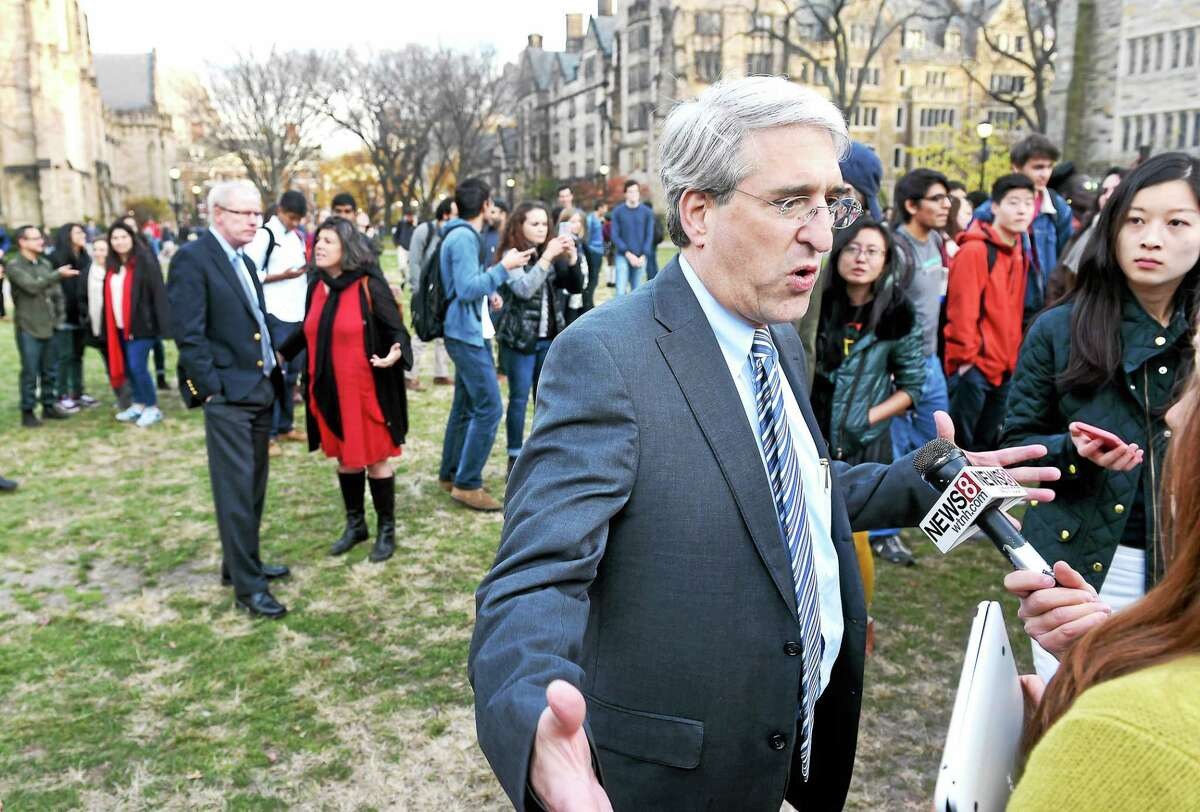 Yale University President Peter Salovey speaks with reporters during a rally by Yale students and faculty Monday in New Haven.