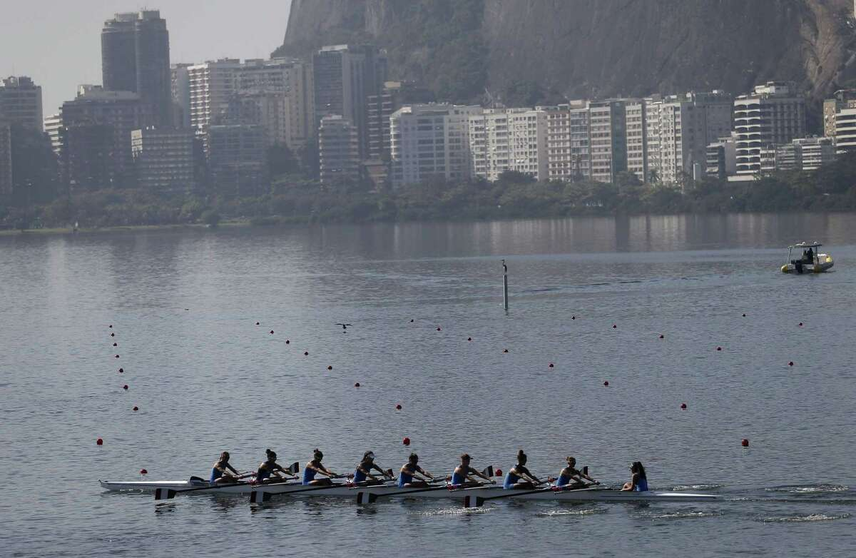 Italian rowers practice for the 2015 World Rowing Junior Championships on Rodrigo de Freitas lake in Rio de Janeiro, Brazil, Tuesday, Aug. 4, 2015. The head of the governing body of world rowing says he will ask for viral testing at the rowing venue for next year's Rio Olympics, and says he expects all other water sports in Rio to follow suit. The move comes after an Associated Press investigation last week showed a serious health risk to about 1,400 Olympic athletes who will compete at water venues around Rio that are rife with human waste and sewage.