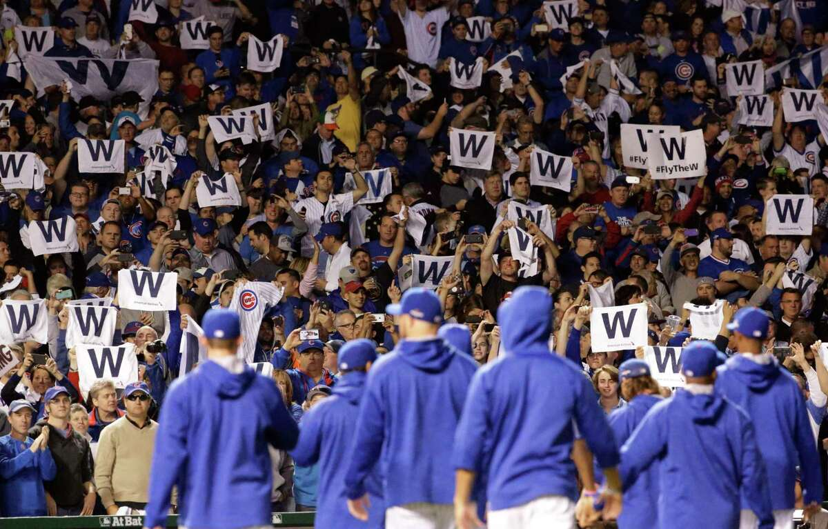 Chicago Cubs fans cheer after Game 3 of the National League Division Series Monday in Chicago.