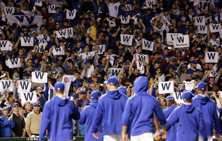 Chicago Cubs fans cheer after Game 3 of the National League Division Series Monday in Chicago. Photo: Nam Y. Huh — The Associated Press   / AP