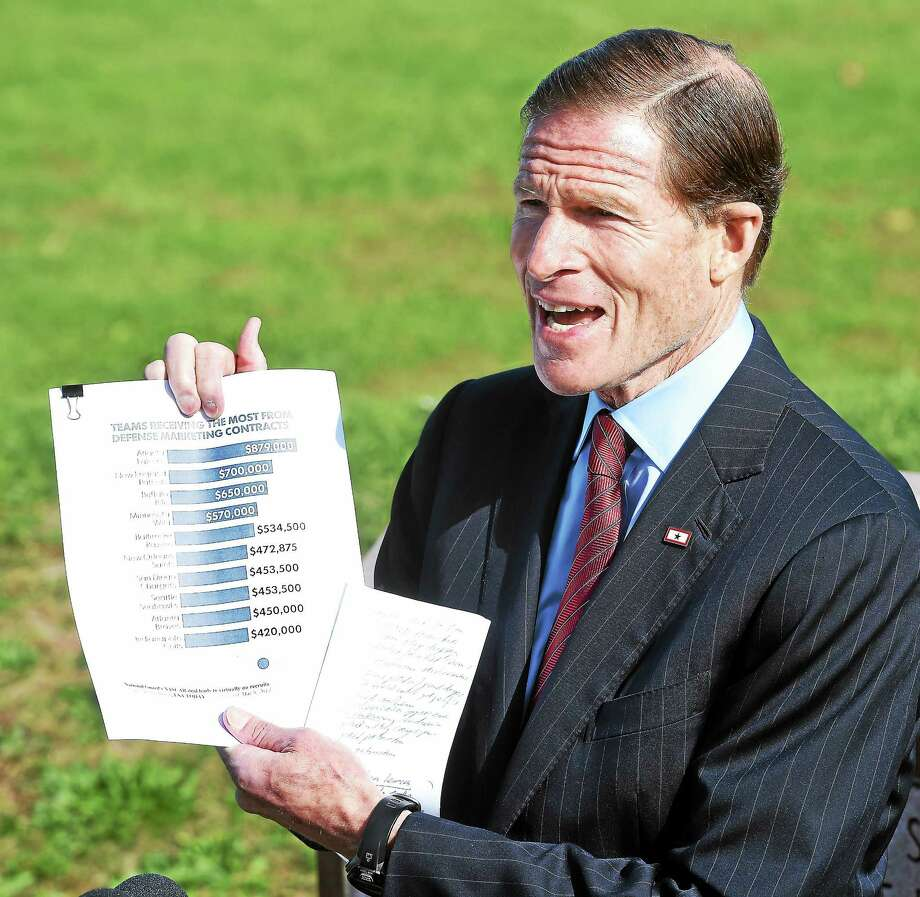 U.S. Sen. Richard Blumenthal displays a list of the highest compensated NFL teams benefiting from defense marketing contracts for patriotic displays and performances, during a press conference Monday in New Haven. Photo: Arnold Gold — New Haven Register