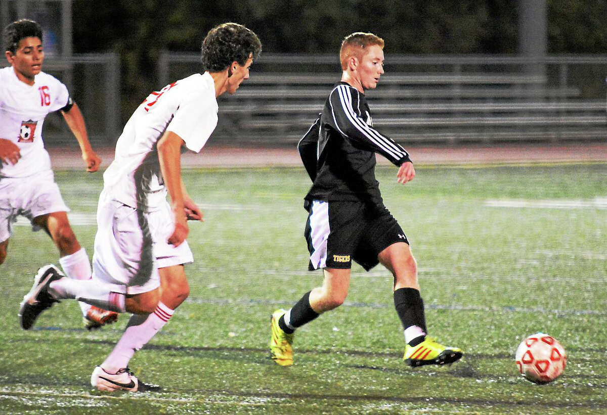 Matt Mills (right) and the Hand boys soccer team look to extend its 34-game unbeaten streak Monday night against Foran.