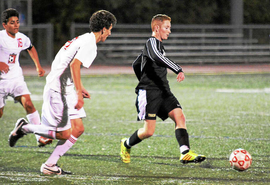 Matt Mills (right) and the Hand boys soccer team look to extend its 34-game unbeaten streak Monday night against Foran. Photo: Dave Phillips -- GameTime CT