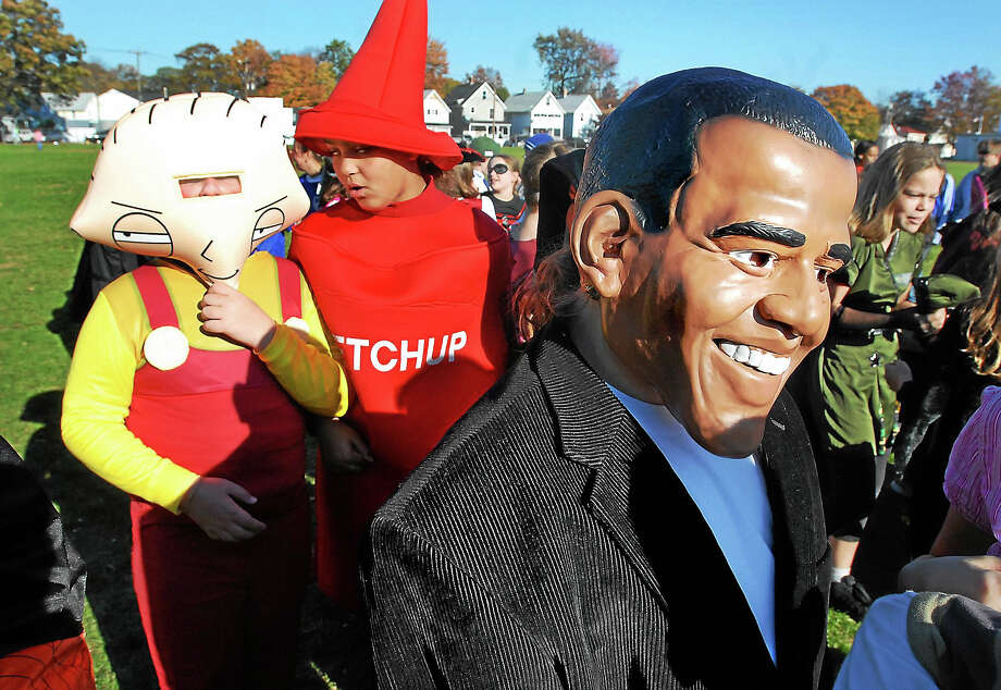 In this 2008 file photo, a school parade is held on Halloween outside of Simon Lake Elementary School in Milford. Photo: Arnold Gold — New Haven Register