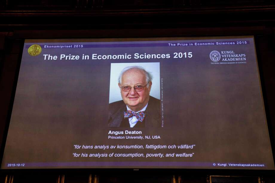"A view of the screen showing an image of Professor Angus Deaton, winner of the 2015 Sveriges Riksbank Prize in Economic Sciences in Memory of Alfred Nobel. Permanent Secretary for the Royal Swedish Academy of Sciences addresses a press conference to announce the winner of the prize at the Royal Swedish Academy of Science in Stockholm, Sweden on Oct. 12, 2015. Scottish economist Angus Deaton has won the Nobel memorial prize in economic sciences for ""his analysis of consumption, poverty, and welfare,"" the Royal Swedish Academy of Sciences said Monday. Photo: Maja Suslin/TT News Agency Via AP   / TT News Agency"