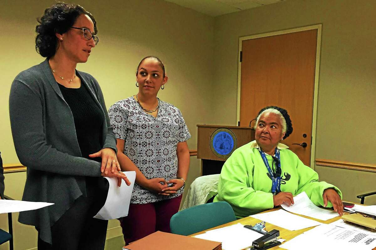 From left, Attorney Amy Marx addresses the Board of Alders' Black and Hispanic Caucus as Church Street South resident Laynette Del Hoyo and Alder Dolores Colón, D-6, look on Monday in New Haven.