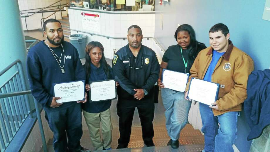 From left, Antwain Hernandez, Tonika Brown, Public Safety Communications Director Michael Briscoe, Anjayla Mitchel and Brandon Tricarico. Students received awards for academic performance. Photo: Shahid Abdul-Karim — New Haven Register