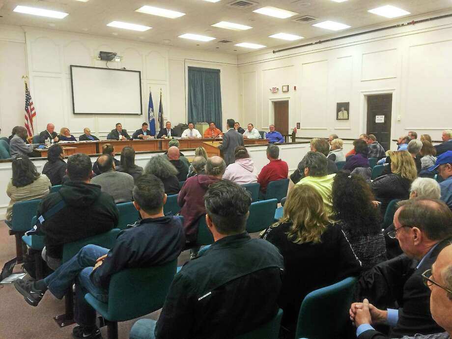 MARK ZARETSKY — NEW HAVEN REGISTER   Dozens of residents attend a West Haven City Council meeting Monday night to speak both for and against a proposed resolution to remove eminent domain from the Haven South municipal development plan. Photo: Journal Register Co.
