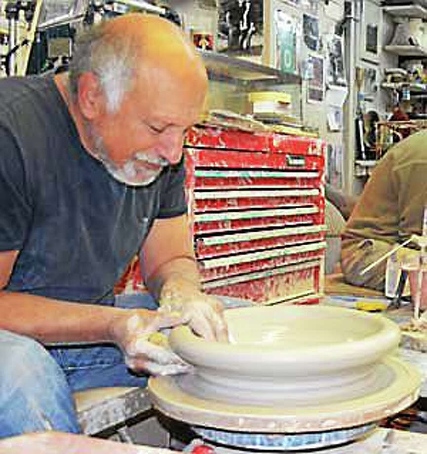Maishe Dickman crafting one of his sought-after dinnerware pieces. Photo: Journal Register Co.